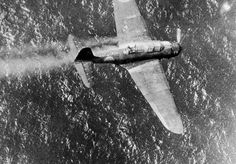 With its gunner visible in the back cockpit, this Japanese dive bomber, smoke streaming from the cowling, is headed for destruction in the water below after being shot down near Truk, Japanese stronghold in the Carolines,on July 2, 1944 - Pin it by GUSTAVO BUESO-JACQUIER