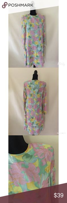 Vintage 100% Silk Dress Gorgeous vintage floral printed dress. 100% Silk. Sheer sleeves with buttons, fully lined. No flaws. Dresses Midi