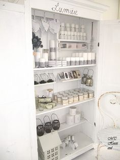 A closet just for candles.... Love the label above the door!