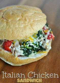 Slow Cooker Italian Chicken Sandwich with roasted red peppers, spinach and cheese.