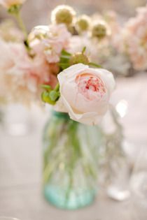 flowers in vintage colored glass or mason jars