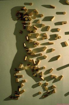 The light on the blocks creates the shadow...amazing