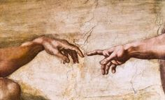 Close-up of God and Adam's hands - Stuart Dee / Getty Images