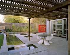 Adams Fleming House by Levitt Goodman Architects, Toronto, Canada | Small fountain spills down to a rectangular pond. (Insets in the patio for trees are a nice modern touch as well.)
