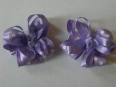 A pair of purple double stacked mini bows by AbraBOWdana on Etsy, $4.00