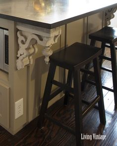 To add age and character, two old corbels were installed under the island overhang.
