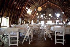 for a country style wedding reception. This would look amazing at night with the lamps and candles lighting the space.