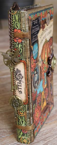 Beautiful altered book by Rebecca Morris at http://www.scrappingontheedge.blogspot.com/ using Graphic 45 Steampunk Spells line.