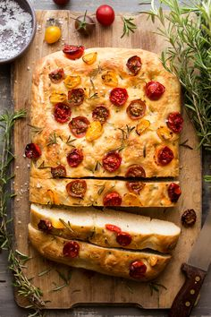 This Italian vegan focaccia with tomatoes and rosemary is fresh, fluffy, fragrant, easy-to-make and completely delicious.