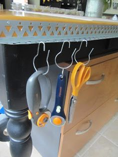 Nail a segment of sheetrock connector to the edge of your craft table and use S-hooks or binder rings to keep tools handy.  Clever!  Sew Many Ways...: Tool Time Tuesday...Mini Metal Shelf
