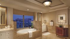 The Ritz-Carlton, Washington D.C. - The Ritz-Carlton Suite features a luxurious marble soaking tub with separate stall shower as well as exclusive Asprey bath amenities