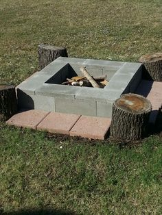 DIY fire pit.. 8 cinder blocks-$1.45 ea, 8 cement caps-$.95 ea., 2 bags lava rock-$2.75 ea., optional 1 ft.x 1 ft.square pavers-$3-ish. Level ground, set blocks tightly, pour in lava rocks, cover block openings with caps. Add pavers. Viola! Done.
