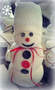 Snowman made out of a sock, rice and some buttons.