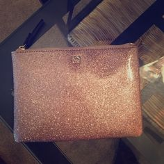 Kate Spade Gorgeous Authentic Rosegold Pouch NWT NWT rose gold Kate Spade mini pouch. Absolutely gorgeous!! Comes with tag and care card. Shiny glittery and stunning ✨ zippered pouch with two pockets inside. kate spade Bags Clutches & Wristlets