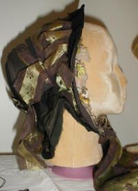 1855 Bonnet of drab colored cloth with all original trim including the strings which are Jacquard woven.
