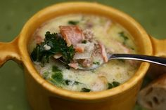 zuppa toscana:  Serves: 10  Prep. Time: 0:35    1 lb. spicy Italian sausage - crumbled  1/2 lb. smoked bacon - chopped  1 qt. water  (2) 14.5 oz. cans (about 3 2/3 cups) chicken broth  2 lg. russet potatoes - scrubbed clean, cubed  2 garlic cloves - peeled, crushed  1 med. onion - peeled, chopped  2 cups chopped kale OR Swiss chard  1 cup heavy whipping cream  salt and pepper - to taste    -In a skillet over medium-high heat, brown sausage, breaking into small pieces as you fry it; drain, set aside.  -In a skillet over medium-high heat, brown bacon; drain, set aside.  -Place water, broth, potatoes, garlic, and onion in a pot; simmer over medium heat until potatoes are tender.  -Add sausage and bacon to pot; simmer for 10 minutes.  -Add kale and cream to pot; season with salt and pepper; heat through.