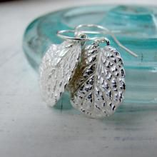 Made using 100% recycled, fine silver to capture each leaf's form perfectly. It create's silver earring that are incredibly luminous, sparkling from each and every vein of these extraordinary earrings. To complete the look the earrings are hung from lovely sterling silver French hooks. | Green Bride Guide