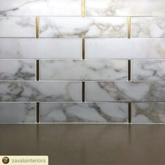 A statement of luxury in this kitchen design by Zavala Interiors. Honed Calacatta Gold marble cut into tiles are used for the backsplash – what really makes this project special is the unconventional use of our Satin finished Gold Hair Liner from ou