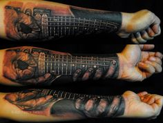 Fantastic forearm guitar tattoo