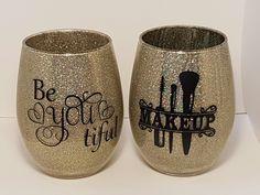 Vinyl decals on glittered stemless wine glass. Vinyl Glasses, Glitter Glasses, Glitter Cups, Glitter Tumblers, Stemless Wine Glasses, Painted Wine Glasses, Makeup Jars, Makeup Brushes, Vinyl Tumblers