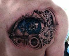 biomechanik tattoo männer rücken auge