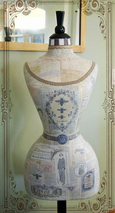 love this french blue news print covered dress form