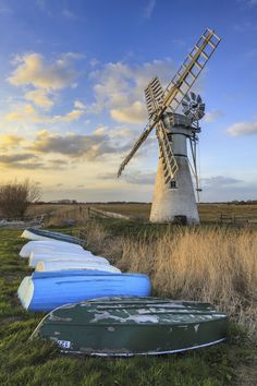 Thurne Dyke Drainage Mill in the Broads National Park. Captured shortly before sunset in April, with upturned boats in the foreground. Tilting At Windmills, Norfolk Broads, Before Sunset, Le Moulin, Cool Places To Visit, Holland, United Kingdom, The Good Place, National Parks