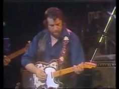 """Waylon Jennings - """"Rainy Day Woman"""" -- """"if it ain't one thing, it's another one on the way."""""""
