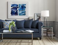 Styled with traditional roll-arms and a sheltering frame, the Durham sofa shows off its contemporary side in deep sapphire blue and a scattering of back pillows that let it sit a little softer and deeper. Nodding to tradition, small-scale nailheads with an antique nickel finish trace the sofa's lines, hand applied with a bit of breathing room between them for a clean, modern feel that feels right in any room. The Durham Sofa is a Crate and Barrel exclusive.