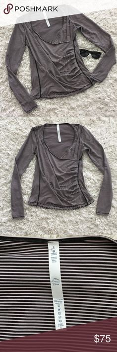 Lululemon Sunset Salutation Wrap Shirt This shirt is new without tags.  It is in new condition!  It is very soft and comfortable. A Greta piece for layering.  Wear it for a workout or as an everyday shirt!  Very versatile piece! lululemon athletica Tops