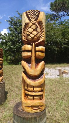 Pelican Parrot Tiki Wood Carving Home Page