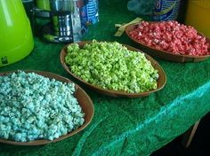 Kool Aid Popcorn: 2 c. Sugar 1 c. Light Corn Syrup ⅔ c. Butter 6 qrts. Popped Popcorn 2 pkg. Kool-Aid (Any Flavor) 1 tsp. Baking Soda. Preheat oven 225 F. Boil sugar, syrup and butter together 3 minutes. On large ungreased baking dish, spread out popped popcorn. In bowl, combine the Kool-Aid with the baking soda. Remove sugar syrup from the stove and carefully stir in the Kool-aid. Poor mix over popcorn, put in oven 30 min