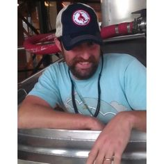 Trucker hat modeled by our gorgeous brewer, Andy.