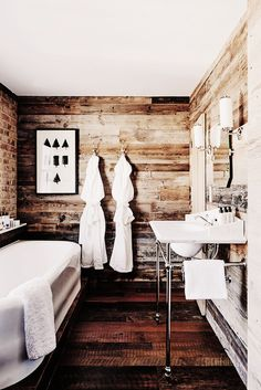 Rustic bathroom with luxurious feeling and bathrobes