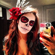 Sugar Skull/ Day of the Dead. My Halloween make up, simple and easy. Liquid eyeliner, red lip stain, and white face cream.