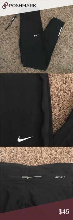 NEW Nike DRI-FIT running pants Brand new without tags, never worn!! They have a snug breathable fit. Back of knees have Dri-Fit mesh for ventilation. With lower leg zippers & reflective strips. Zipper pocket in back. Super amazing tights!! FIRM PRICE Nike Pants Track Pants & Joggers
