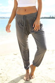 Get über comfy in these drop crotch slouch pants in a jersey-feel fabric. With pleats from the waist, drawstrings at the front & cuffed at the ankles, they are an extremely relaxed fit & perfect paired with a white basic singlet. Ideal for a workout at the gym or simply to lounge around in. We love! By Sabo Skirt.