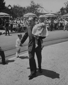 #WaltDisney and his grandkids at #Disneyland. #disney
