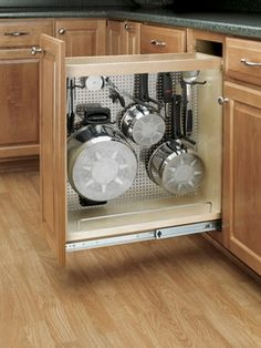 "Pull out drawer for pots and pans... Space saver and don't have to worry about people seeing your ""ugly and old"" pans, like if you had an overhead hanging rack."