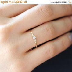 14k solid gold simple 3 diamonds ring. (Pls send us convo for over a size 8) -This ring is available in yellow,white or rose gold. Perfect as a simple engagement ring! -Setting and band made with solid 14k gold. << Product details >> -14k solid gold -Center:0.04 carat diamond -