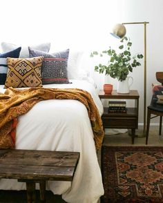 Bohemian bedroom inspiration | wood + white, greenery, wood bench, and tons of texture.
