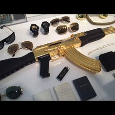 Rich Kids of Instagram: gold plated AK47 $9,000 Some how I think you have failed your child!
