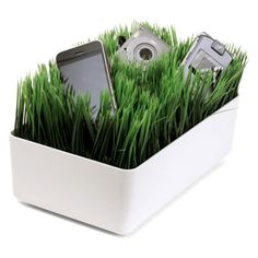 charging station on grass for smartphone, degital camera and portable game device … 芝生のデジタルガジェットステーション「チャージング ステーション」