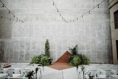 This industrial ceremony space is modern and chic with a hint of organic charm   Image by Jaicee Morgan