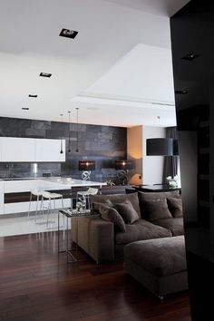 Extraordinary Eco Minimalist Apartment With Bright Accents : Gorgeous Eco Minimalist Apartment With Bright Accents With White Black Natural Stone Wall Chandelier Brown Sofa Pillow Table Dining Table Bar Stool Lamp Window Curtain