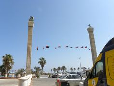 statues are on top of the pillars - Tripoli, Libya