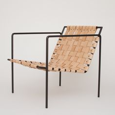 Rod+Weave Chair | Remodelista - ridiculous, i know, but maybe i could remake my chairs with a riveter and leather straps?