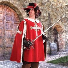 The elite guard of the infamous Cardinal Richelieu wore this tabard as a sign of his office. This blood red tabard is made of heavy red cotton velvet with an antique gold rayon lining. Embroidered cro