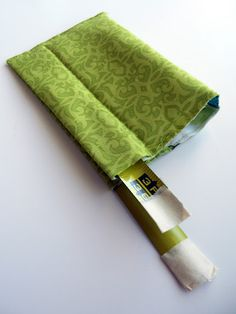 A clever use of a metal tape measure for a snap opening pouch