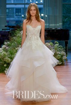"Brides.com: . ""Tresor,"" Chantilly lace strapless sweetheart ballgown with cascading asymmetrical tulle skirt by Monique Lhuillier"